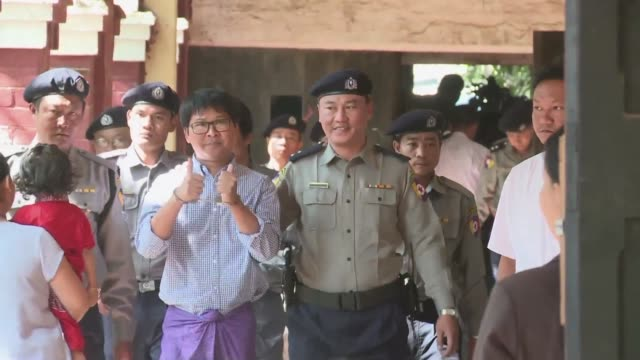 Two Reuters reporters accused of breaching Myanmar's secrecy law arrive in court as judges are due to decide whether to grant them bail