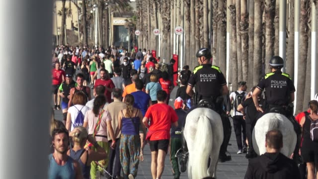 two riders from barcelona metropolitan police on horseback watch the area while people exercise outdoor as lockdown eases during the coronavirus... - lockdown stock videos & royalty-free footage