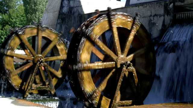 two rotating water mills 4k resulation - water wheel stock videos and b-roll footage