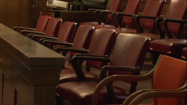 two rows of chairs wait for a jury. - justice concept stock videos & royalty-free footage
