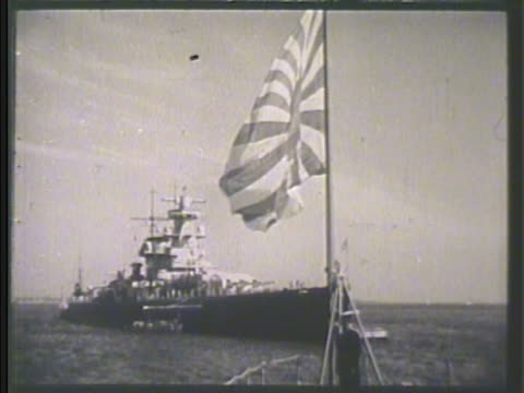 two rows of imperial japanese navy, ijn, soldiers standing w/ rifles on deck of warship. japanese flag flying on ship, battleship at sea bg.... - warship stock videos & royalty-free footage