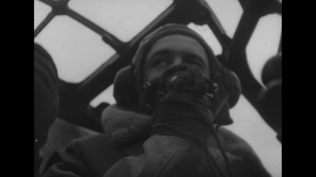 stockvideo's en b-roll-footage met two royal canadian air force flight crew members getting into bomber / bomber taxiing / shot inside plane of copilot and member of crew in cockpit /... - british military