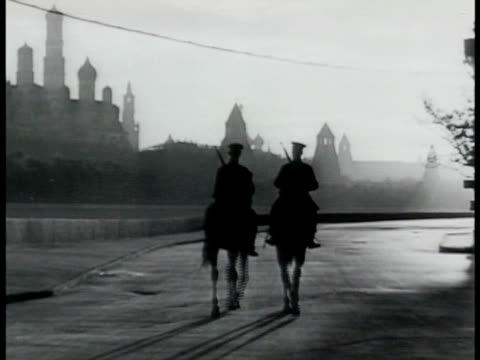 dawn two russian calvary soldiers patrolling red square horses walking side by side ws north side of red square state historical museum w/ same... - 1943 stock videos & royalty-free footage