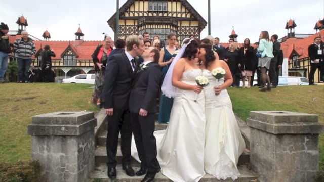 two same sex couples get hitched in one of new zealands first gay marriage ceremonies clean same sex couples tie knot in new zealand on august 19... - rotorua stock videos and b-roll footage