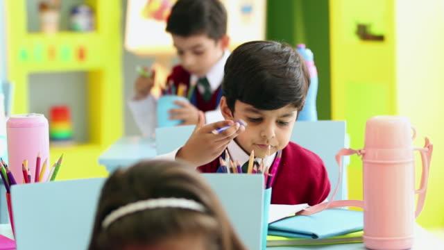 two school students studying in the classroom, delhi, india - schulkind nur jungen stock-videos und b-roll-filmmaterial