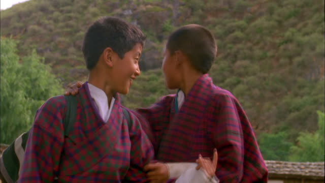 two schoolboys pose for camera in thimphu available in hd. - bhutan stock videos & royalty-free footage