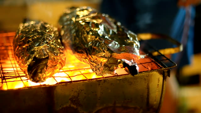 Two sea fish are cooked on barbecue.