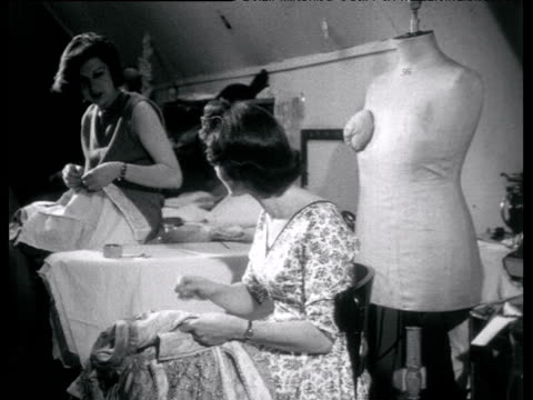 two seamstresses sewing costumes and chatting - bbc archive stock-videos und b-roll-filmmaterial