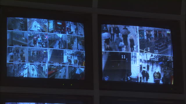 CU, Two security surveillance monitors with view of London streets, London, England