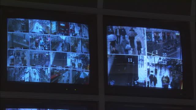 cu, two security surveillance monitors with view of london streets, london, england - telecamera di sorveglianza video stock e b–roll