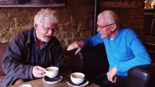 Two Senior Adults Chatting over Coffee
