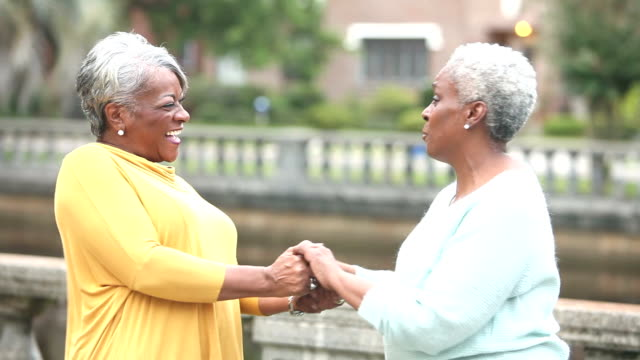 Two Senior African American women saying goodbyes