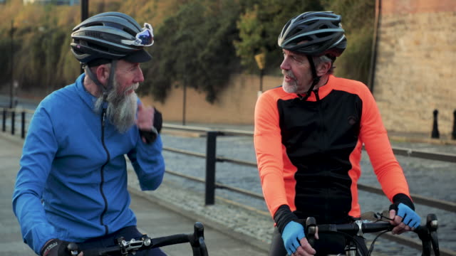two senior cyclists chatting - sports helmet stock videos & royalty-free footage