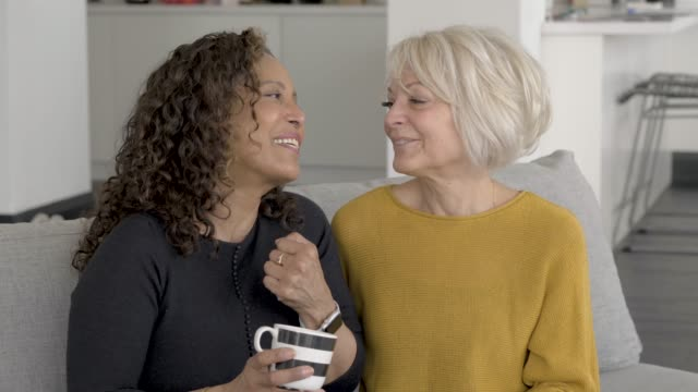 two senior females laughing and spending time together - beautiful people stock videos & royalty-free footage
