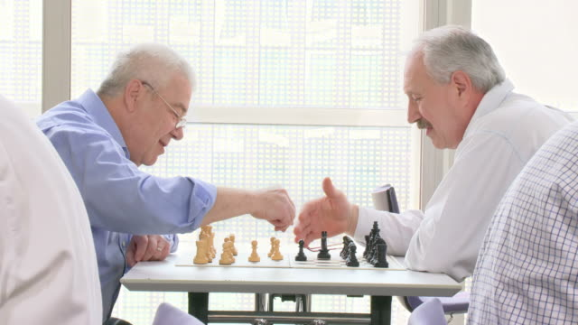 HD: Two Senior Men Playing Chess