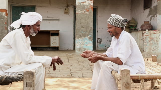 Two senior men talking, Haryana, India