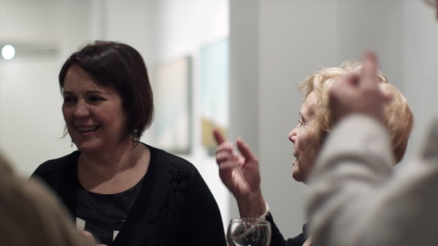 ms two senior women chatting in art gallery opening / bilbao, vizcaya, spain. - art gallery stock videos and b-roll footage