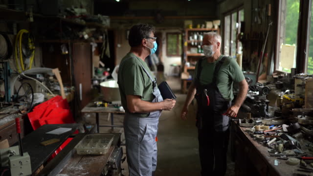 two seniors talking after they finished work in workshop - working seniors stock videos & royalty-free footage