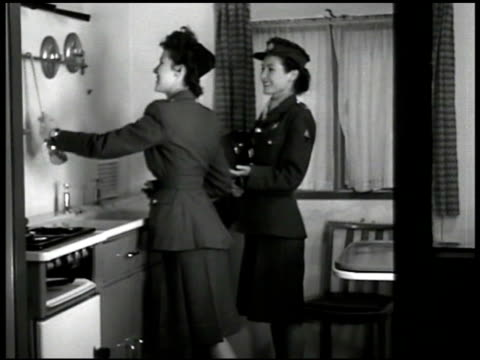 dramatization two service women in kitchen 'how do you think johnny would like to live here' 'you can make plenty of space' - postwar stock videos and b-roll footage