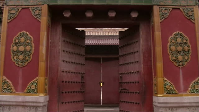 two sets of doors open into the forbidden city. - forbidden city stock videos & royalty-free footage