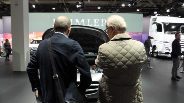 two shareholders talk about vehicles on display at the annual daimler ag shareholders meeting on may 22, 2019 in berlin, germany. daimler has... - annual general meeting stock videos & royalty-free footage