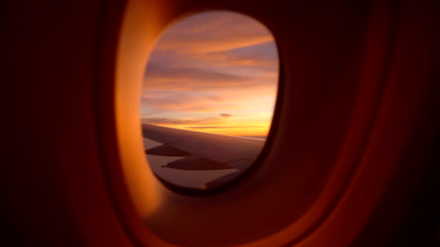 two shot looking the window of airplane with beautiful colorful sky in the morning - aircraft point of view stock videos & royalty-free footage