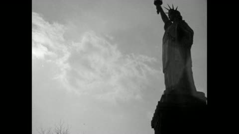 two shots from boat of statue of liberty / shot from below of statue / tilt up statue / shot from top of statue of building below on bedloe's island... - statue of liberty new york city stock videos & royalty-free footage