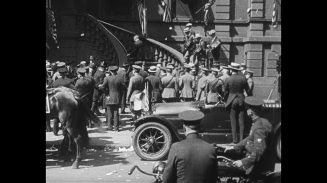two shots from moving vehicle of open car carrying gen john pershing commander of american expeditionary force driving down street past crowd on... - back to front stock videos & royalty-free footage