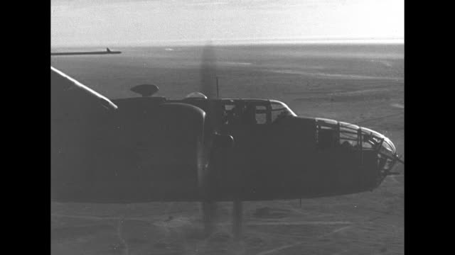 two shots from plane of us bombers flying in formation / shot from plane of bomber in fight / shot from plane of bombers flying above / artillery... - bomber plane stock videos & royalty-free footage
