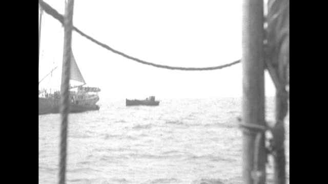 two shots from schooner of freighter at sea / shot from schooner of threemasted sailing ship in distance / two shots from schooner of two small boats... - telephoto lens stock videos & royalty-free footage