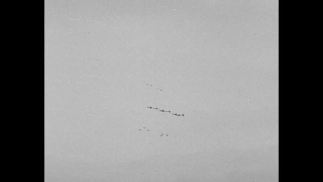 two shots of biplanes flying in formation over floyd bennett field / planes flying overhead in formations in different directions at different... - airshow stock videos & royalty-free footage