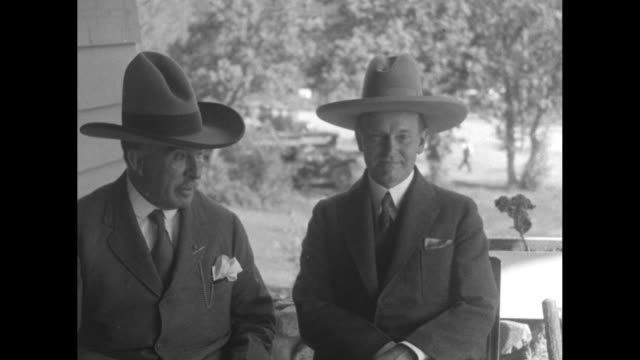 two shots of coolidge on right and us army gen leonard wood governorgeneral of the philippines sitting outdoors together and talking while posing for... - coolidge calvin stock videos & royalty-free footage
