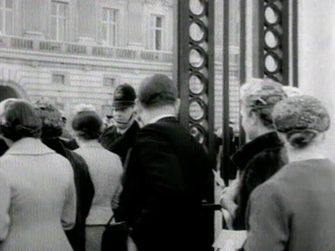 two shots of debutantes and their families walking into the grounds of buckingham palace 1958 - debutante stock videos & royalty-free footage