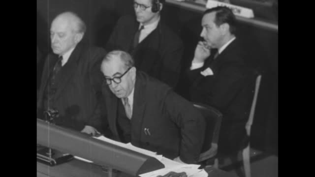 two shots of ernst reuter governing mayor of berlin seated at table speaking about free elections in berlin another west german envoy seated next to... - 1951 stock-videos und b-roll-filmmaterial