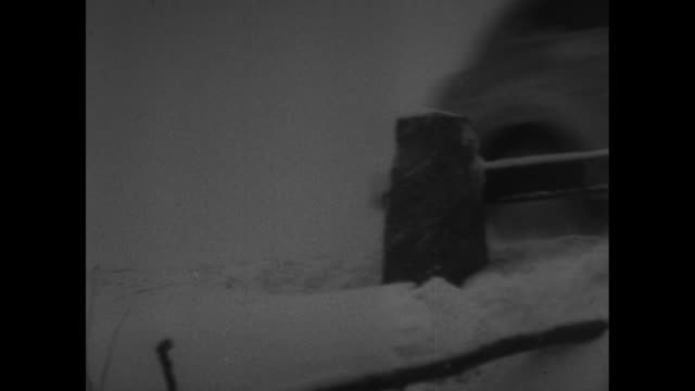 two shots of finnish soldiers walking with horses along road, snow on ground / car driving fast along road past camera / wagons loaded with hay and... - hay stock videos & royalty-free footage