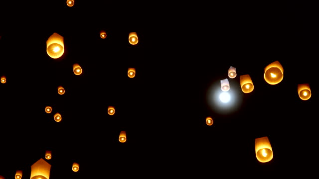 two shots of floating lanterns with full moon - ceremony stock videos & royalty-free footage