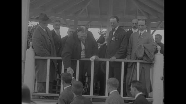 two shots of former president william howard taft standing on stage of gazebo speaking officials sitting behind him / taft on stage bending over and... - gazebo stock videos and b-roll footage