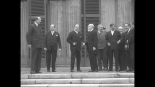 two shots of french prime minister andre tardieu on left, hands in pockets, with members of his cabinet on porch front of building, french pres. paul... - hands in pockets stock videos & royalty-free footage