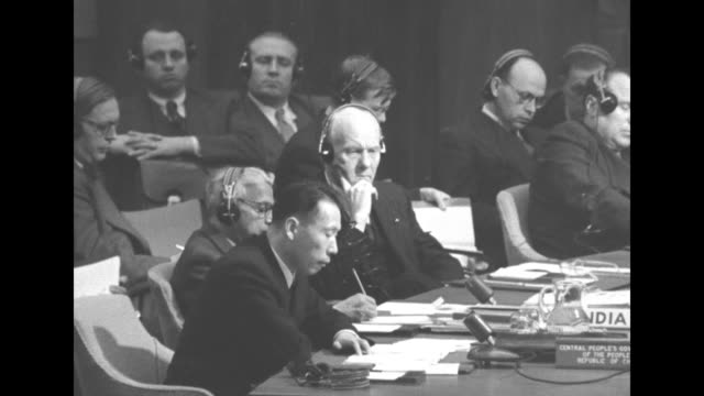 two shots of gen. wu xiuquan sitting at end of large horseshoe-shaped desk speaking about china's military support of north korean forces, other un... - north america stock videos & royalty-free footage