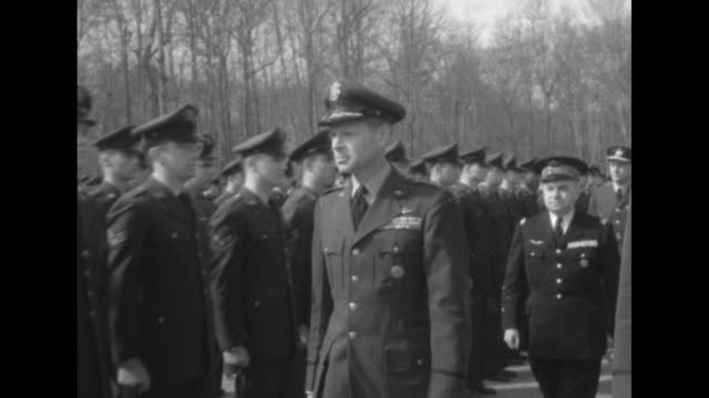 two shots of group of nato officers walking along front of formation of nato officers inspecting them / close view of nato officers standing in... - central europe stock videos and b-roll footage