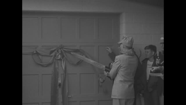 two shots of group of people standing in front of door to building housing train, governor walter johnson holding scissors for ribbon-cutting /... - cut video transition stock videos & royalty-free footage