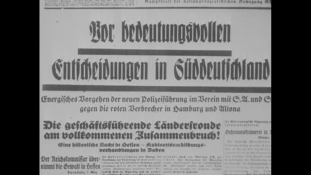 "two shots of headlines in newspapers in german / nazi poster on wall / two shots of headlines in newspapers in german / title card: ""meeting of... - poster stock-videos und b-roll-filmmaterial"