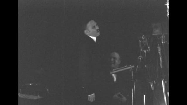 two shots of lightfoot solomon michaux standing at pulpit preaching during religious service / note exact day not known - 礼拝点の映像素材/bロール