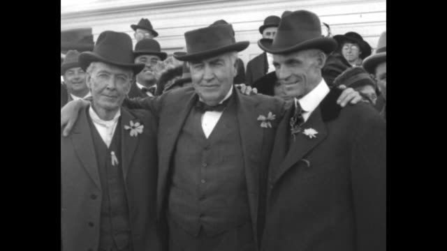 two shots of luther burbank on left thomas edison in middle and henry ford on right standing together for photo opportunity edison with his arms... - 発明家点の映像素材/bロール