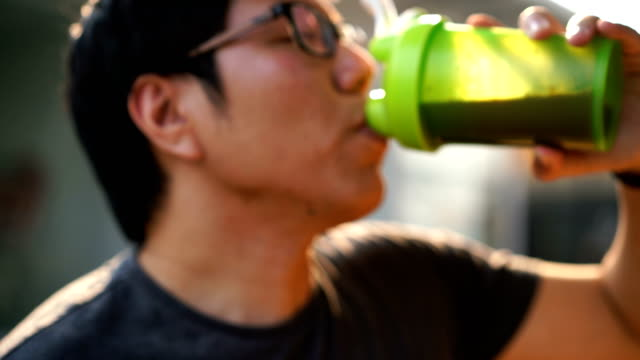 Two Shots of Man Drinking Whey Protein from Shaker Bottle Blender