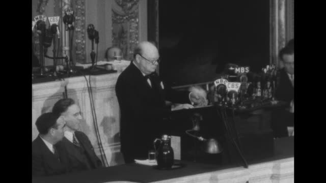 two shots of members of congress sitting and listening in house of representatives' chamber of us congress / sot british prime minister winston... - winston churchill prime minister stock videos & royalty-free footage