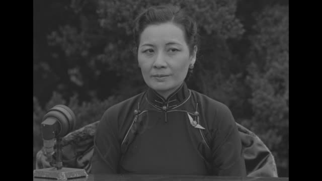 two shots of mme chiang kai-shek, wife of chinese president chiang kai-shek, speaking on speaker's platform inside mott street chinese school / mme.... - chiang kai shek stock videos & royalty-free footage