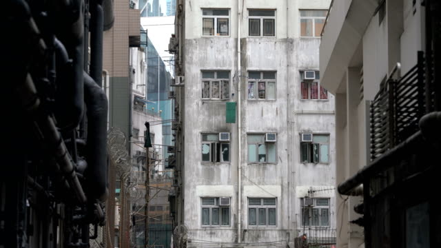two shots of old apartment in hong kong - air conditioner stock videos and b-roll footage