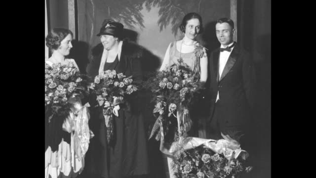 two shots of opera singer frances gettys holding bouquet of roses standing next to male opera singer and two other female opera singers holding roses... - omaha stock videos & royalty-free footage