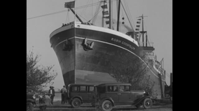 "two shots of people and parked cars gathered in front of prow of steamship ""robin goodfellow"" sitting on bank of river / three shots of people... - robin day stock videos & royalty-free footage"